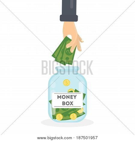 Putting money in money box on white background. Concept of savings.