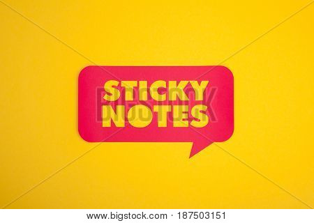 From above sticky notes words cut out in the red bubble isolated on yellow.