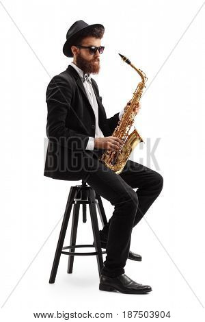 Jazz musician with a saxophone sitting on a chair isolated on white background