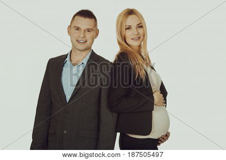 Pregnant businesswoman with her partner