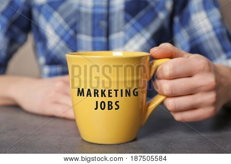Marketing jobs concept. Woman holding cup, closeup