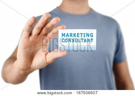 Man holding business card in hand, closeup. Marketing consultant concept