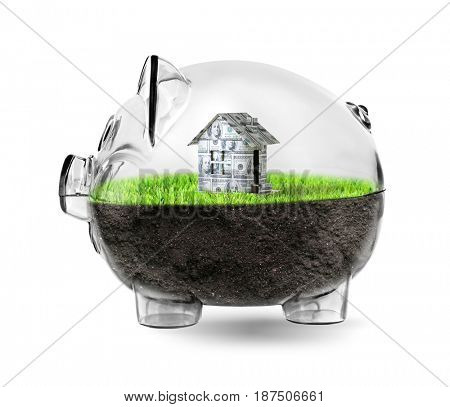 Piggy bank with house made of money on white background. Financial savings concept