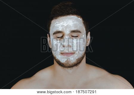 Man with cream moisturizer on his face.