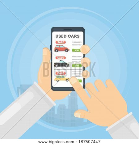 Used cars app. Hands hld smartphone with used cars selling.