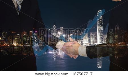 Double Exposure Of Businessman Shaking Hand With Growth Graph Chart And Blurred City Background.