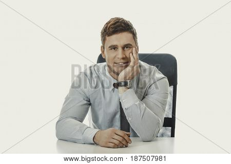 Businessman sitting by a desk in the office.