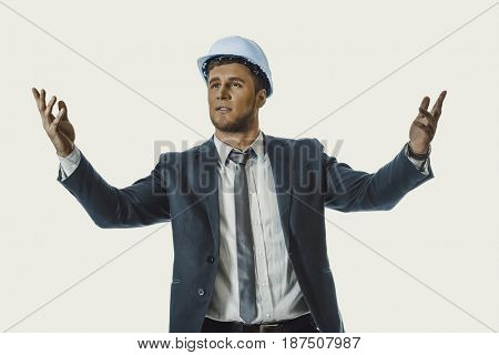 Businessman in hard hat holding copyspace.