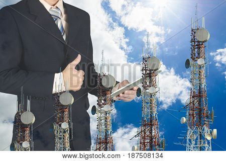 Double Exposure Of Businessman Using Tablet And Give Thumbs Up On Blue Sky