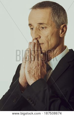 Portrait of businessman with clenched hands
