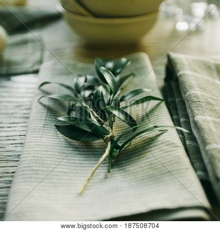 Rosemary Essential Oil In A Glass Bottle With Fresh Green Rosemary Herb On Old Wooden Table.rosemary