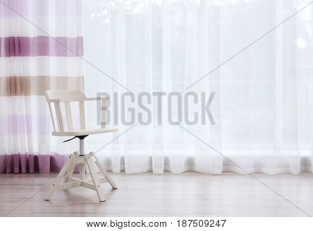Chair on curtain background