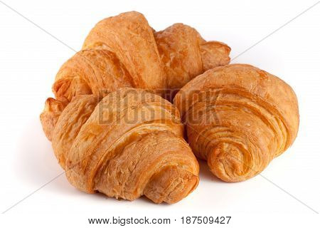 three croissant isolated on white background closeup.
