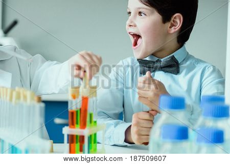Excited Schoolboy With Flasks In Chemical Lab, Science School Concept