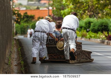 Toboggan riders on sledge in Monte - Funchal Madeira island - Portugal