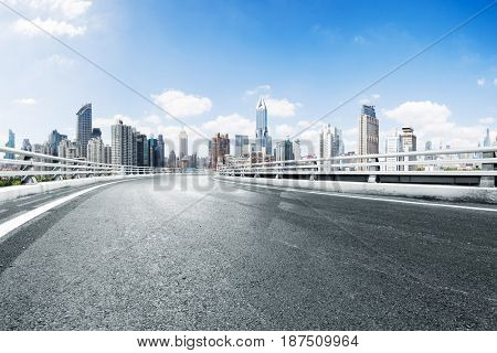 empty road in midtown of shanghai in blue cloud sky