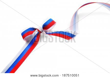 Ribbon bow in colors of Russian flag on white background