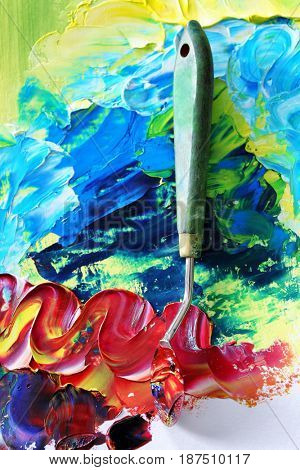 Colorful oil paint with palette knife, closeup