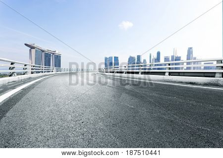 empty road with landmark buildings in singapore