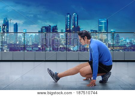 Portrait Of Asian Man Doing Training Before Running Workout