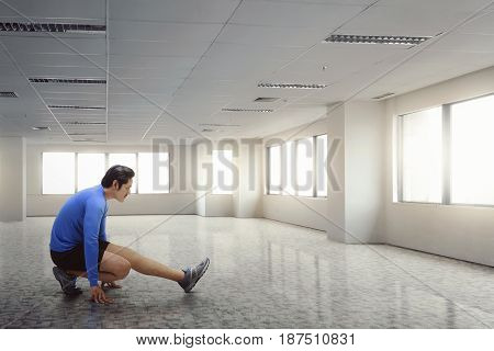 Fitness Asian Man Stretching His Legs After Running Exercise