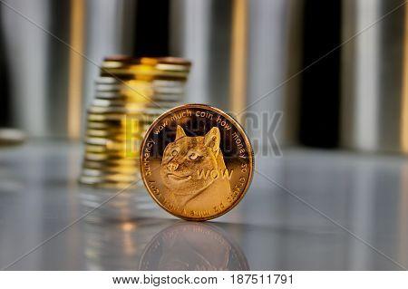 Digital currency physical brass dogecoin coin in dark scene