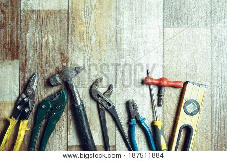 Working tools on wooden rustic background. top view
