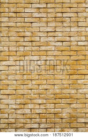 Brickwork. The wall of the house painted yellow brick.