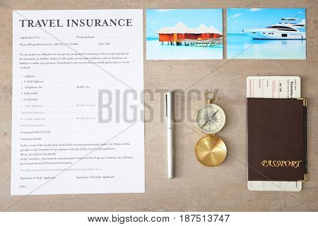 Insurance form with passport and photos on light background