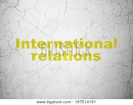 Politics concept: Yellow International Relations on textured concrete wall background