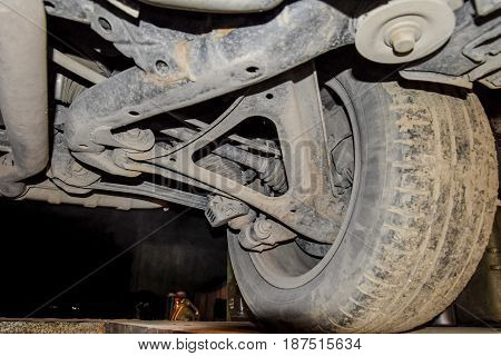 Rear Wheel Of The Car With The Elements Of The Suspension System. Car Service