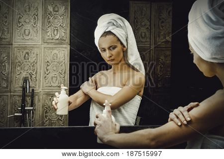 Woman with body lotion.