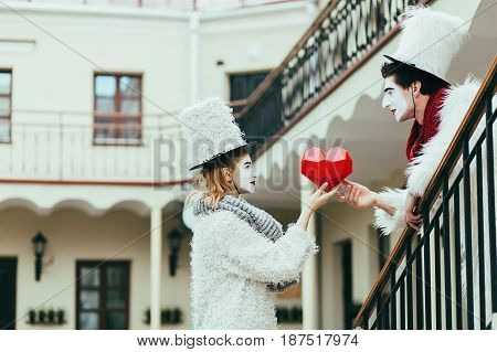 Romantic couple of mimes with a red heart