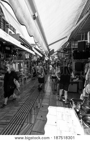 HERAKLION GREECE - JULY 09 2016: Crete. The popular market and shopping street №1866 in the historic center of the city. Black and white. Heraklion - the largest city on the island.