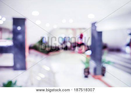 Abstract Blurred Background: Office Building Hallway With People ,business Centre,blue Tone