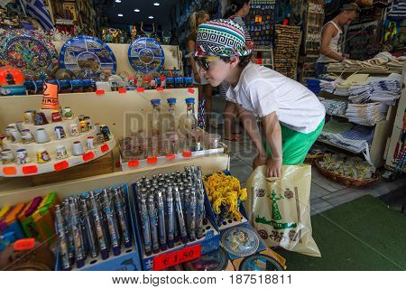 HERAKLION GREECE - JULY 09 2016: Crete. Traditional Cretan souvenirs and gifts. A child sees a showcase. Heraklion - the largest city on the island.