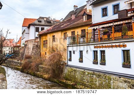 Cesky Krumlov, Czech Republic - February 26, 2017: Famous landmark, historic center street and river