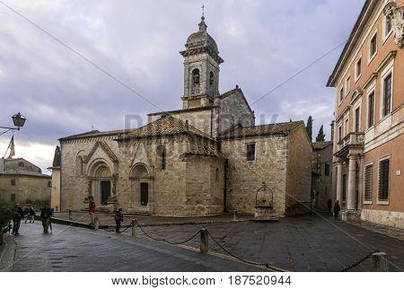 SAN QUIRICO D'ORCIA,ITALY-APRIL 24,2016::Church in the San Quirico town square during a cloudy day.