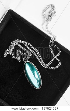 Elegant vintage aquamarine medallion in jewel box closeup