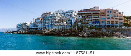 AGIOS NIKOLAOS GREECE - JULY 11 2016: Panoramic view of the embankment of a popular tourist town - Agios Nikolaos Crete's northern coast.