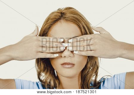 Woman covering her face with both hands.