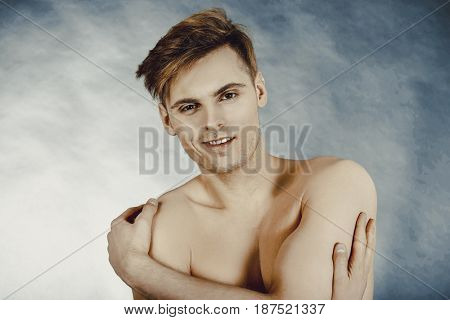 Young smiling man.