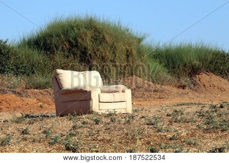Sofa on the field with harvested crop