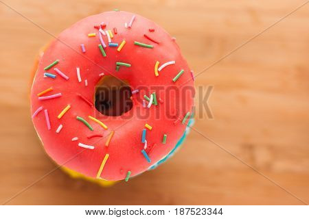 Donuts On A Wooden Background. Junk Food. Fast Food.