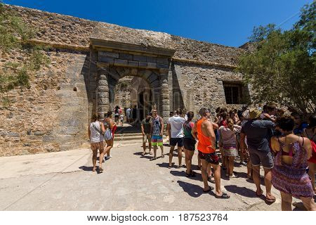 CRETE GREECE - JULY 11 2016: Tourists on Spinalonga island and fortress of the same name. Tourists on tours in the fortress.