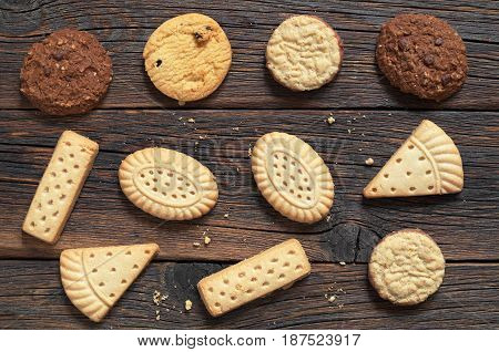 Old wooden background with various shortbread cookies top view
