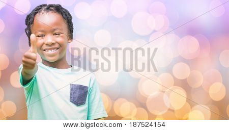 Digital composite of Happy girl showing thumbs up over bokeh
