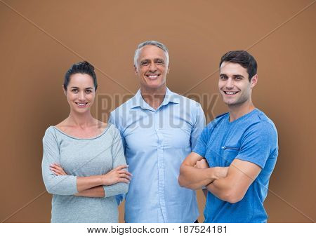 Digital composite of Casual business people standing over colored background