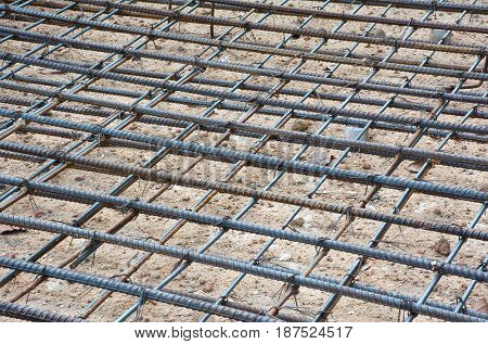 Soft focused picture of Re-bar steel or deformed bar for constructure building tie with wire on site