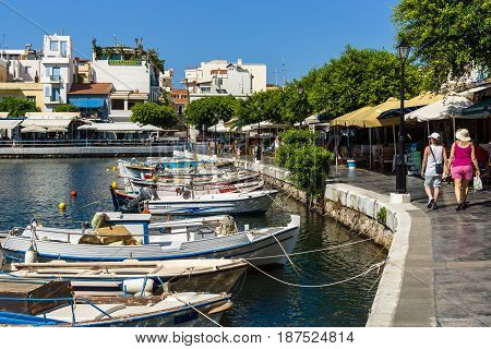 CRETE GREECE - JULY 11 2016: The embankment of a coastal elite tourist town on the Greek island of Crete - Agios Nikolaos.